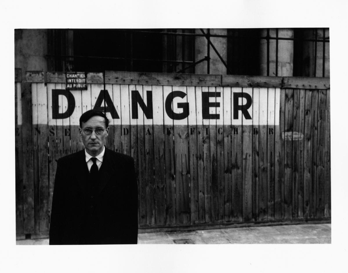 Portrait of William S Burroughs in front of the Théâtre Odeon, 1959. © Brion Gysin, Naked Lunch series, Paris, October 1959 © The Barry Miles Archive