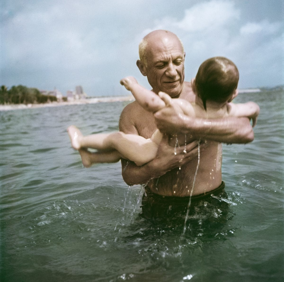 Pablo Picasso playing in the water with his son Claude, Vallauris, France, 1948. © Robert Capa/International Center of Photography/Magnum Photos.