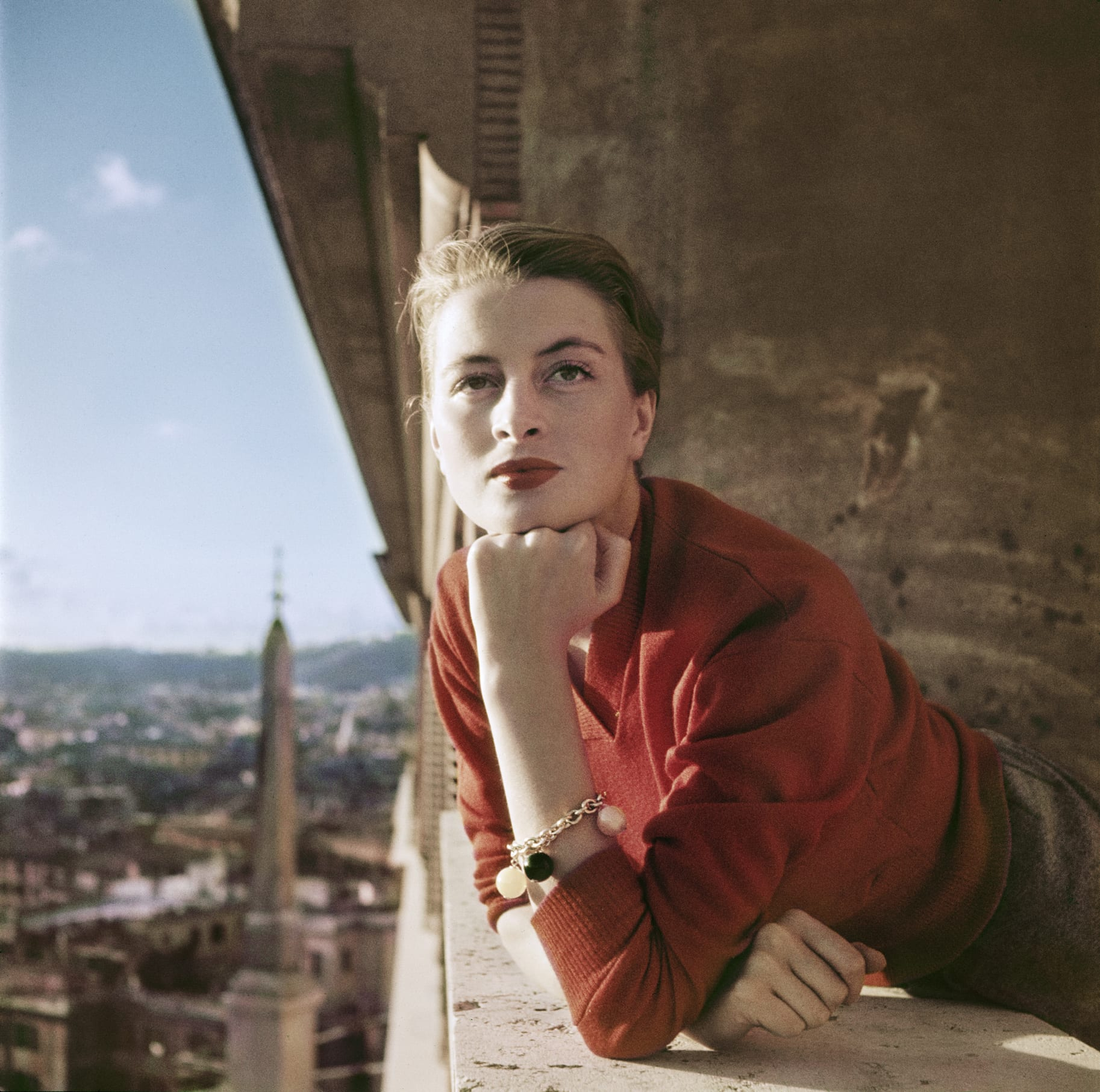 Capucine, French model and actress, on a balcony, Rome, August 1951. ©Robert Capa/International Center of Photography/Magnum Photos.