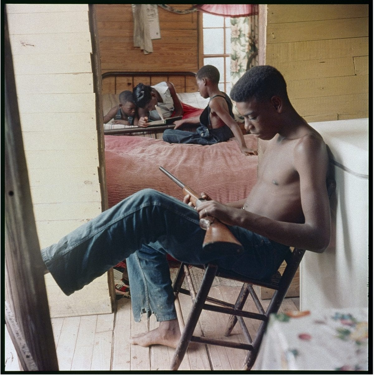 Gordon Parks (American, 1912–2006), Willie Causey, Jr., with Gun During Violence in Alabama, Shady Grove, Alabama, 1956, courtesy of and copyright The Gordon Parks Foundation.
