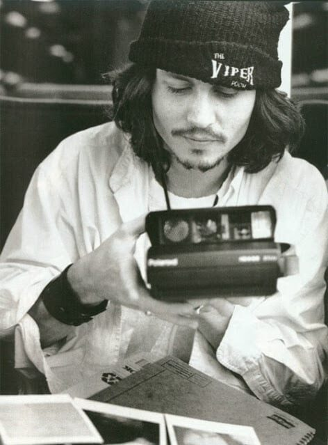 Johnny-Depp-with-camera-polaroid
