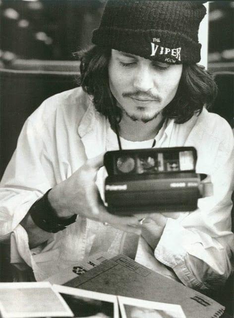 Johnny-Depp-with-camera-polaroid