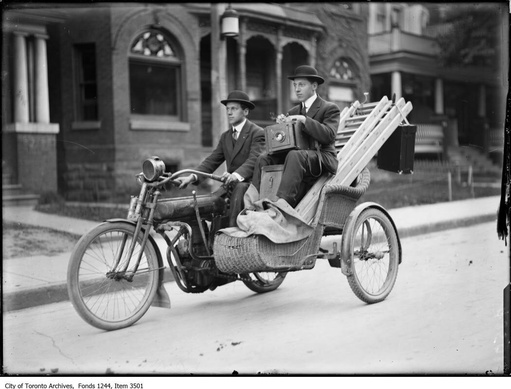 Photographers Bill and Joseph James on a motorcycle. - 1912