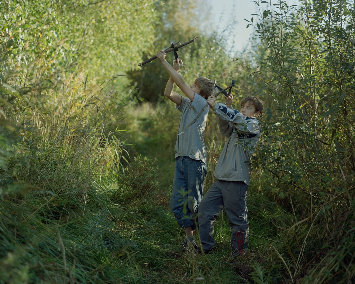 Dima and Vlad playing in the woods. Daugavgriva, 2011.