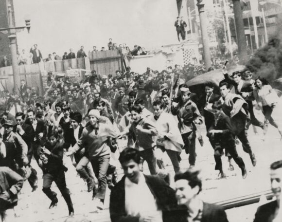 """Film Still from """"Los Adventureros' Plaza Bolivar, Bogota, 1968. A movie that imagined a revolution in South America. Directed by Lewis Gilbert starring Olivia De Havaland and Charles Asnavor etc. Copyright free*"""